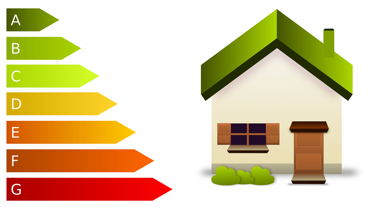 Cartoon home with a green roof and green shrubbery to signify energy savings with a quality roof system.