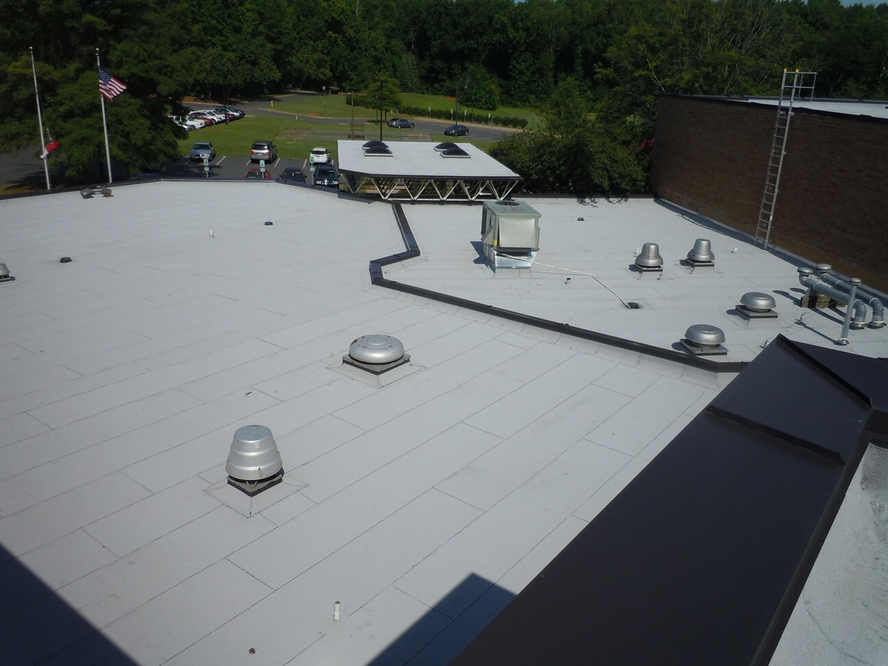 Flat roof protected with rolled-on asphalt which has stuck to the deck to seal any leaks.